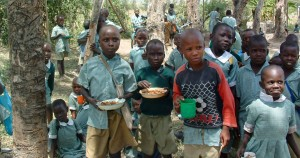 African children with food bowls